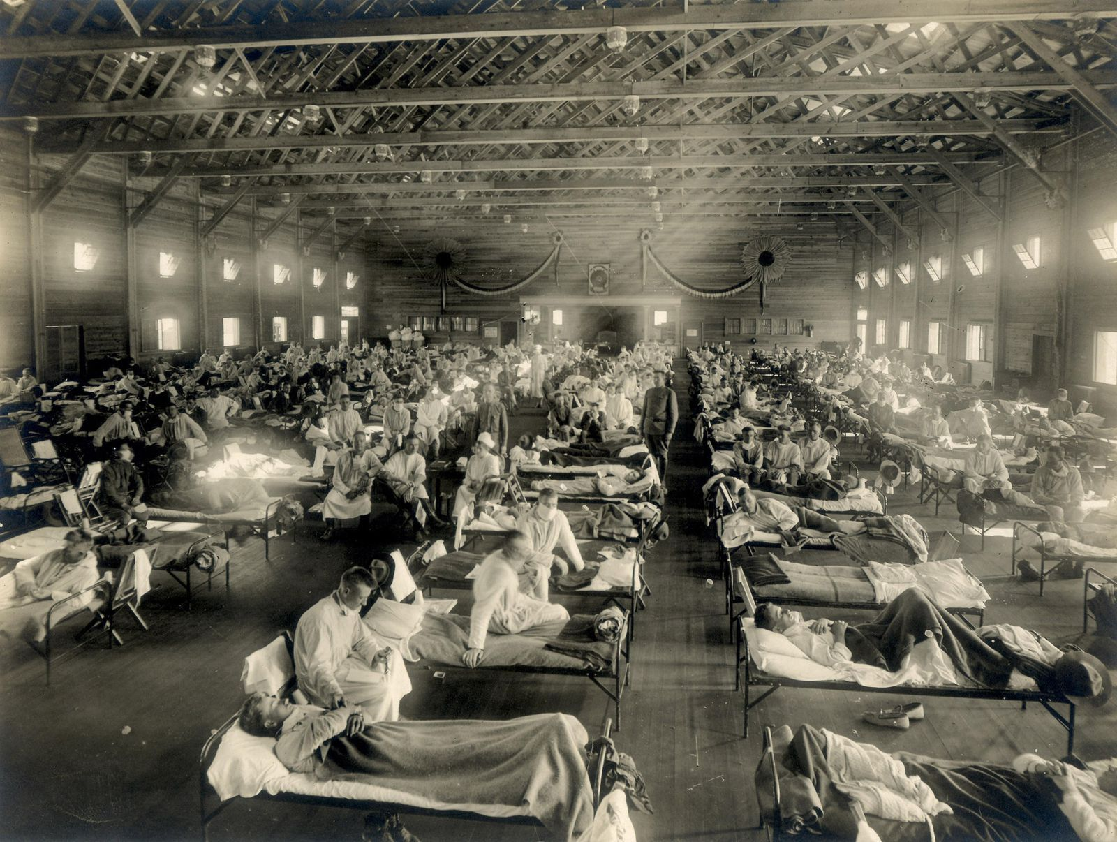 "An emergency hospital at Camp Funston, Kansas, 1918. ""Of the 12 men who slept in my squad room, 7 were ill at one time,"" a soldier recalled."