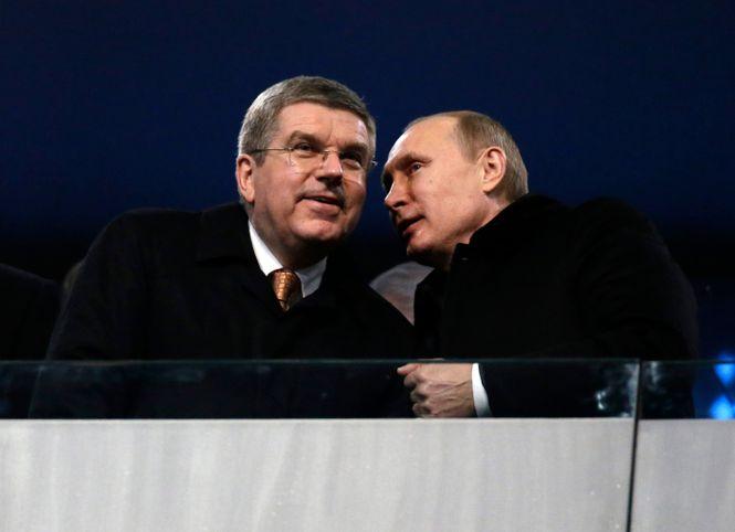 Putin und Bach tuschelnd